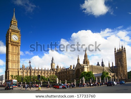 Big Ben, Westminster Palace, London. Wide angle view with london bus and taxis. - stock photo