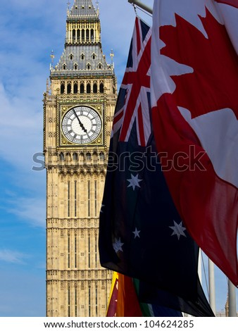 Big Ben with different flags - stock photo