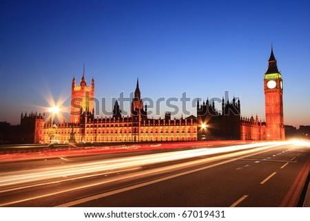 Big Ben with long light beam at twilight time, London, UK - stock photo