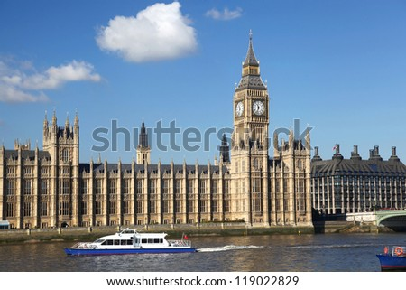 Big Ben with motor boat in London, England - stock photo