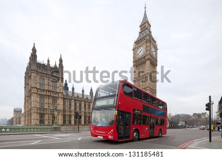 Big Ben with red double-decker in London, UK. Cityscape  shot with tilt-shift lens maintaining verticals - stock photo