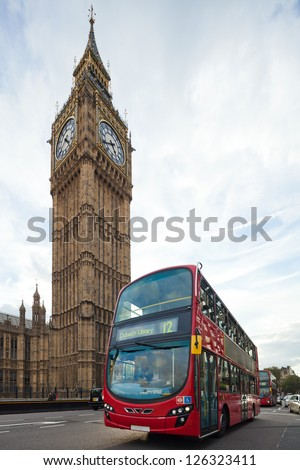 Big Ben with red double-decker in London, UK. Cityscape shot with tilt-shift lens, the vertical lines of the object stored - stock photo