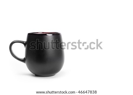 Big black ceramics cup isolated on white with copyspace. - stock photo