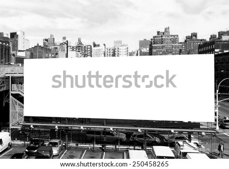 Big blank billboard sign in New York City, surrounded by highrise buildings. Black and white image ready for custom copy. - stock photo