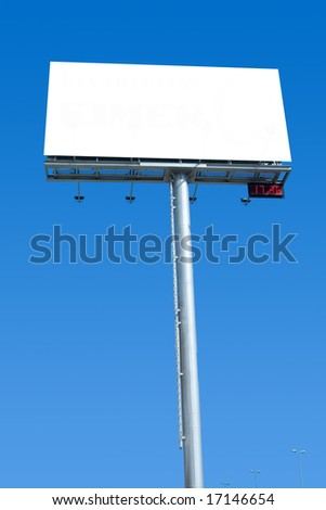 Big blank billboard with digital clock during rush hour - stock photo