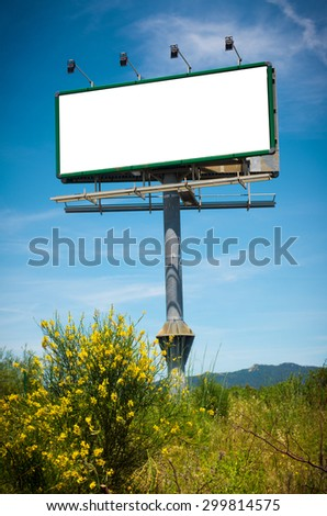 Big blank billboard with lamps against a deep blue sky