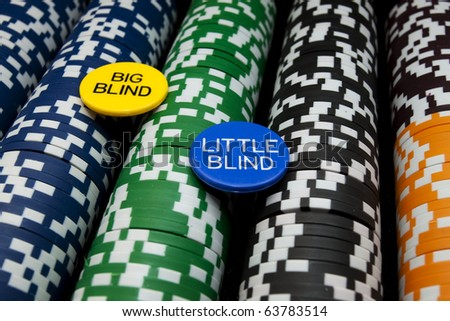 Big Blind Little Blind Rows of multi colored poker chips with big and little blind buttons. Horizontal. - stock photo