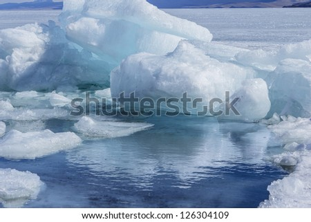 Big blocks of the broken ice and thawed snow