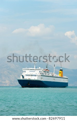 Big blue ferry boat at the sea