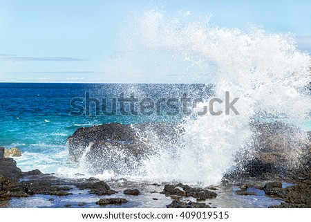 Big blue ocean waves breaking on the shore with foam. Scenic view of splashing ocean water. Copy space. Empty place for message. Outdoor. Travel, freedom, adventure, success, business concept. - stock photo