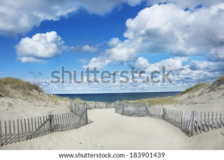 Big blue sky, clouds and dunes at Race Point Beach on Cape Cod, Provincetown, Massachusetts - stock photo