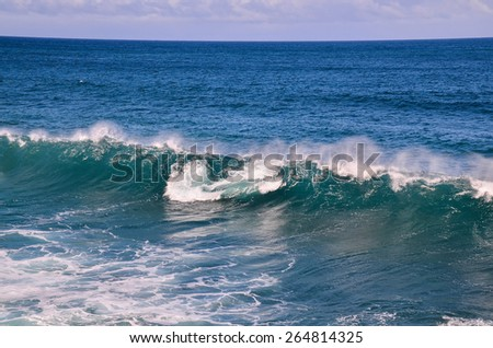 Big Blue Wave Breaks in the Atlantic Ocean