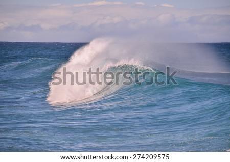 Big Blue Wave Breaks in the Atlantic Ocean - stock photo