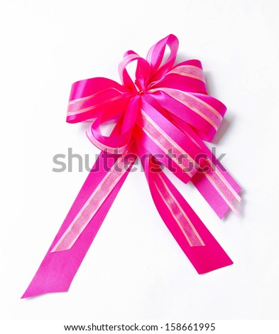 Big bow of pink ribbon on white background