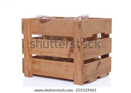 Big box for glassware. Wooden box for glass made in vintage style. - stock photo