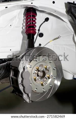 Big brake disk of a modern racing car. Brake disk. - stock photo