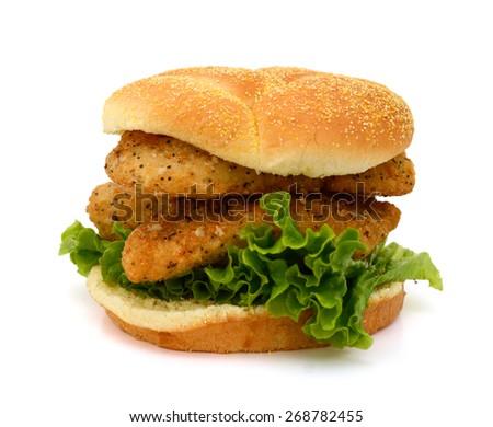 big breaded fish sandwich on white background  - stock photo