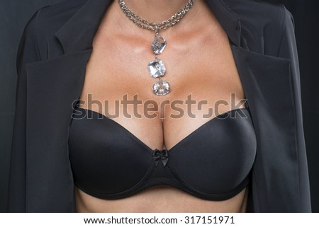 Big Breasts Lady In Sexy Corset and necklace jewelry - stock photo