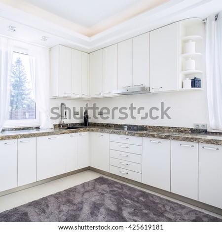 Big bright kitchen with modern equipment - stock photo