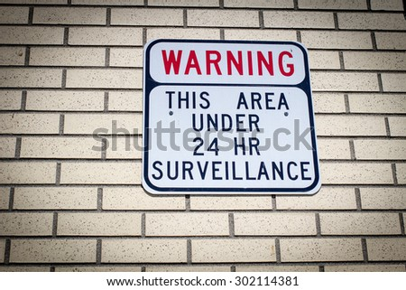 Big Brother Is Watching. Warning sign for would be intruders and those who desire privacy. - stock photo