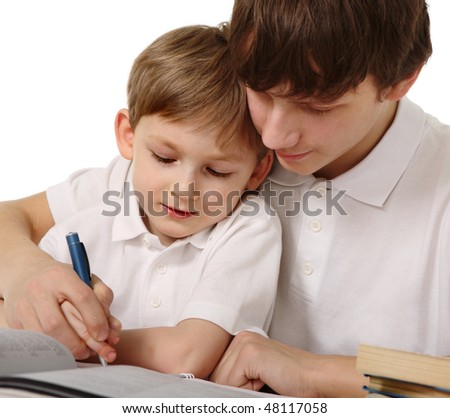 Big brother trains the younger brother - stock photo