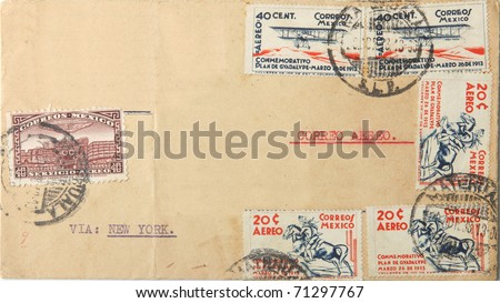 Big brown envelope with many Mexican postage stamps sent as airmail via New York - stock photo