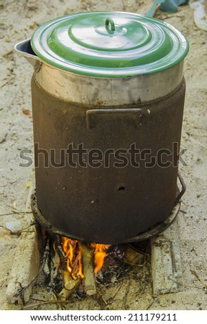 big brown pan on the big fire - stock photo