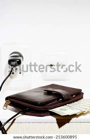 big brown wallet with bills for $ 100 worth for charging - stock photo