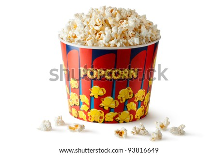 Big bucket of popcorn. Isolated on a white. - stock photo
