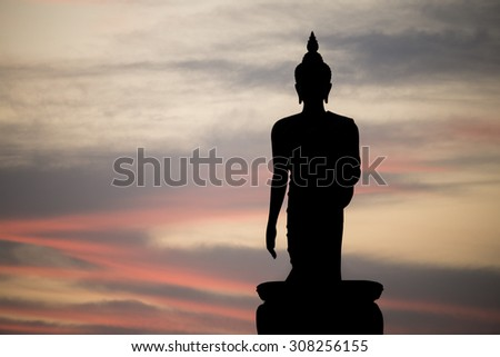 Big Buddha image silhouette in the evening light - stock photo