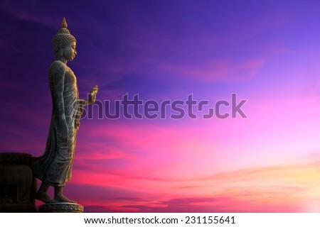 Big Buddha statue on sunrise sky - stock photo