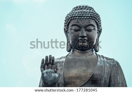 Big buddha statue on the mountain in Hong Kong. - stock photo