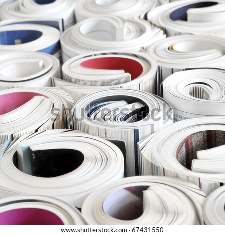 Big bulk of rolled up colorful magazines - stock photo