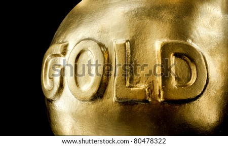 Big bullion of gold. Isolated on black - stock photo