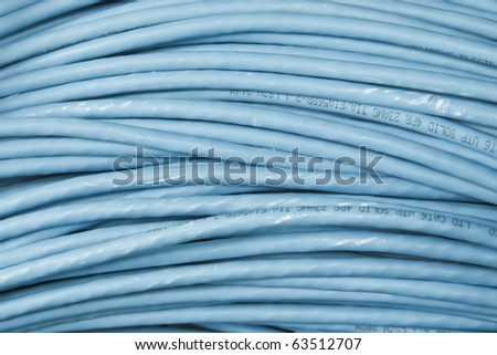 big bunch of blue network cable - stock photo