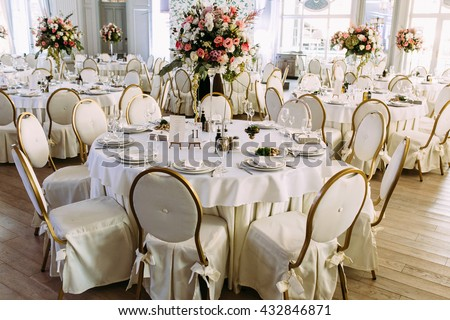 Big bunch of colorful flowers on the wedding table - stock photo