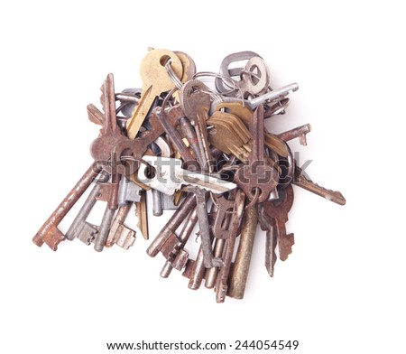 Big bunch of old keys isolated on white - stock photo