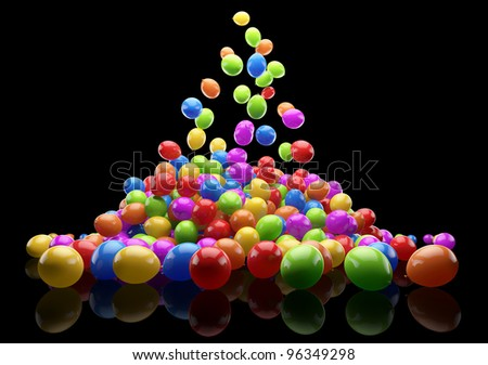 Big bunch of party balloons. Layered on the floor. Isolated on black background.