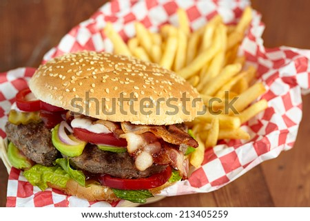 Big Burger with Avocado, Bacon And Fries - stock photo
