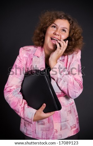 big businesswoman talking on mobile phone - stock photo