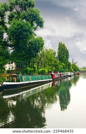 Big canal way with long narrow boats  - stock photo