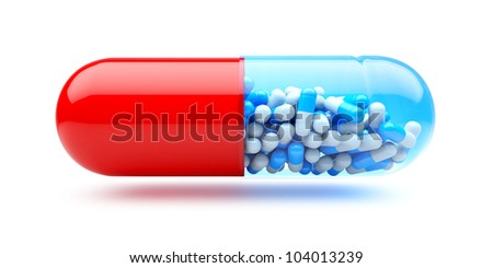 Big capsule with small capsules. Medicines concept.