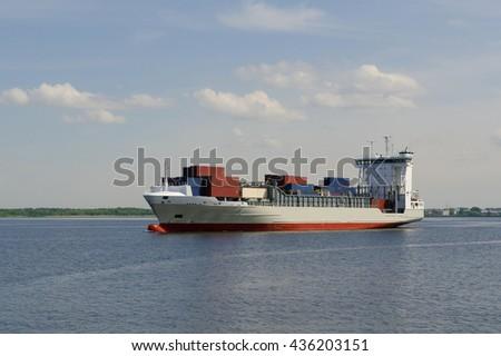 Big Cargo ship sailing in still water - stock photo