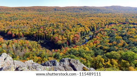 Big Carp River in fall color - stock photo