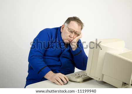 Big catching a nap at the computer - stock photo