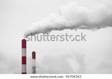 Big chimney with smoke polluting the world - stock photo