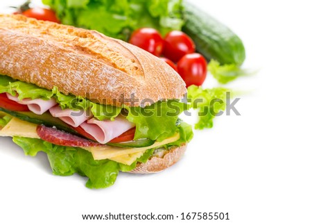Big Ciabatta Sandwich with lettuce, slices of fresh tomatoes, ham, salami and cheese and ingredients isolated on white - stock photo