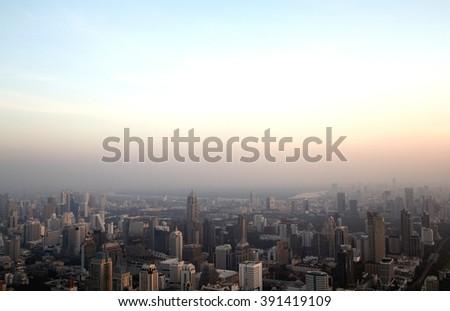 Big city in misty sunrise, Bangkok, Thailand - stock photo