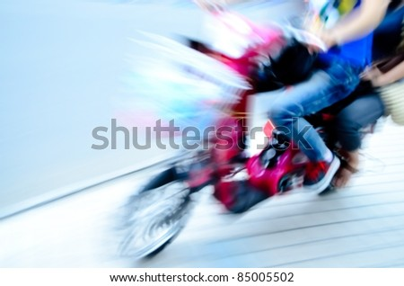 big city motor bicycle driver blur motion - stock photo
