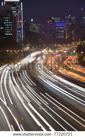 big city night lights illumination highway heavy traffic rush hour blur vehicle lights cars moving transportation of street roads - stock photo